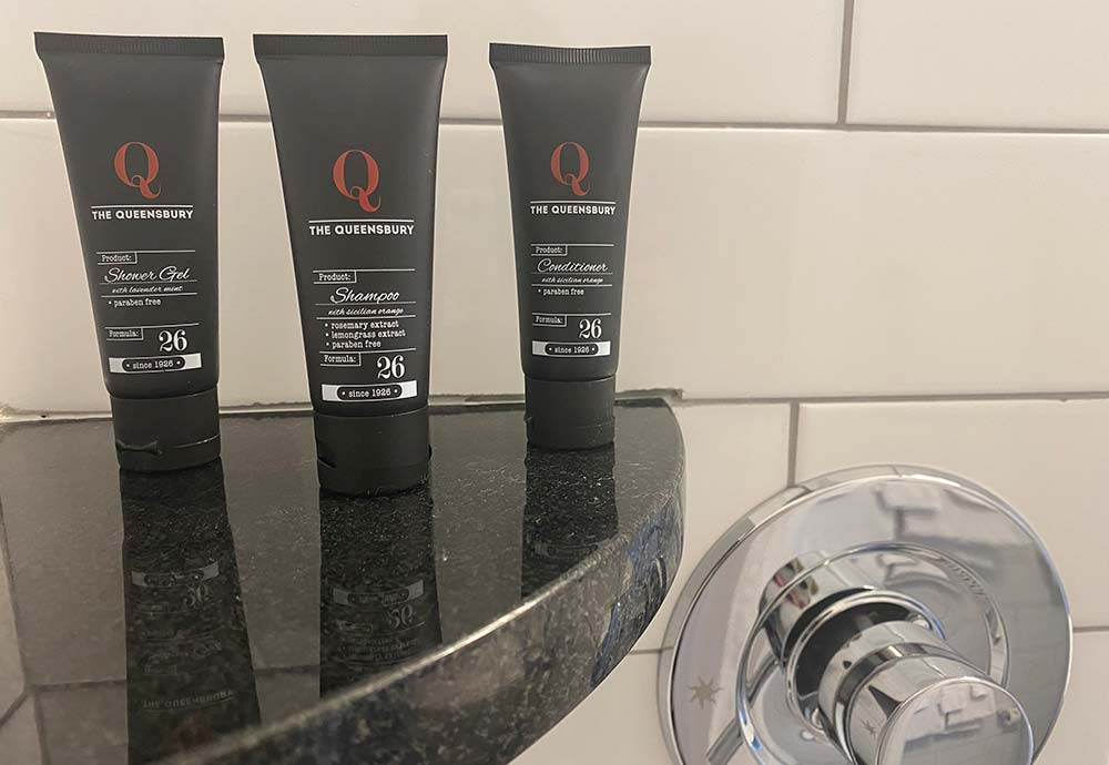 shower and conditioner bottles in shower