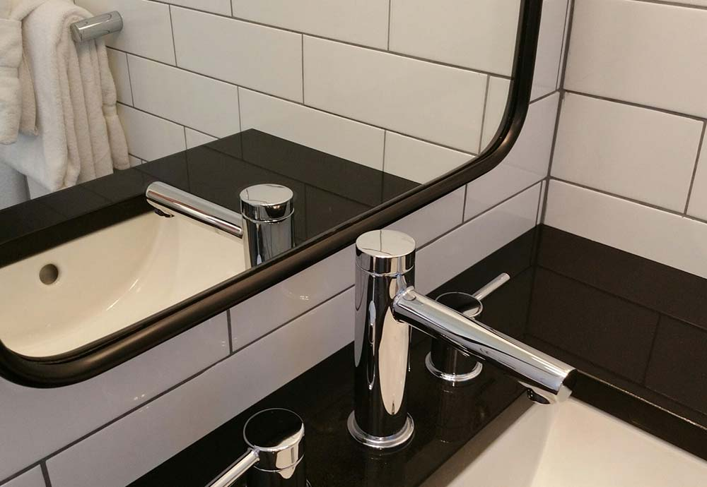 close up faucet on vanity