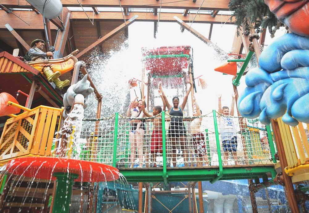 Group getting splashed in Indoor Water Park