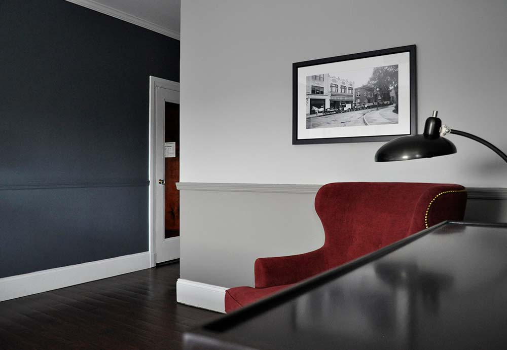 hotel room with lamp and red chair