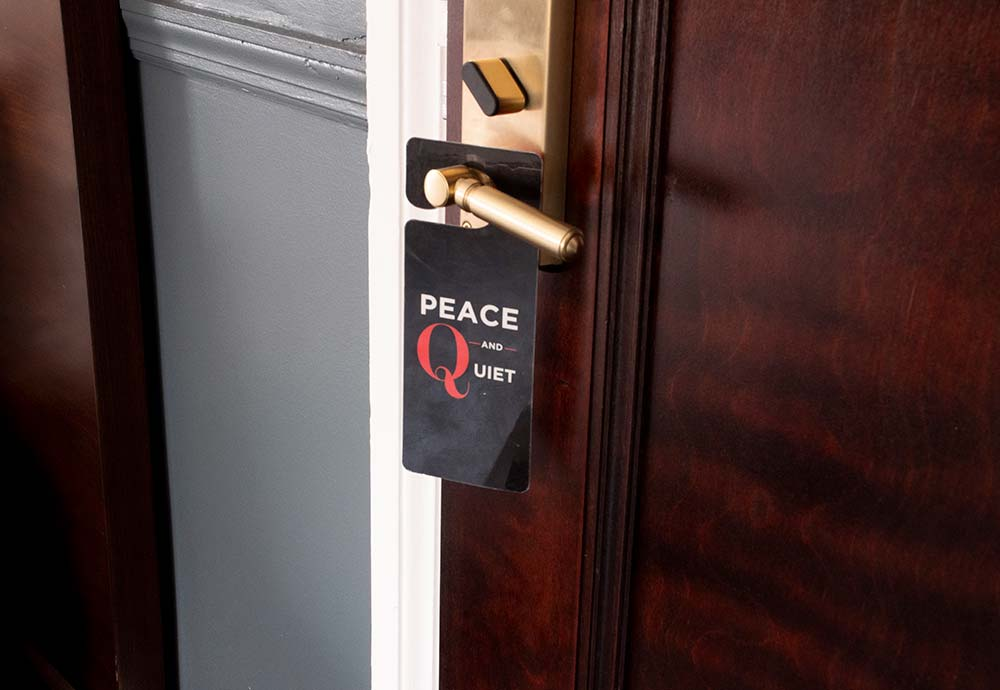 Peace and quiet sign on hotel door knob