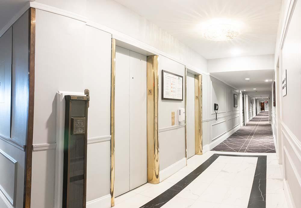Hotel hallway with 2 elevators