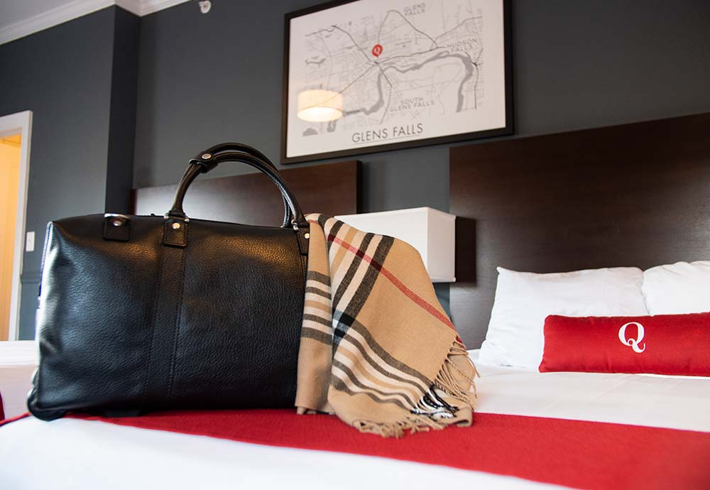 Leather bag on bed