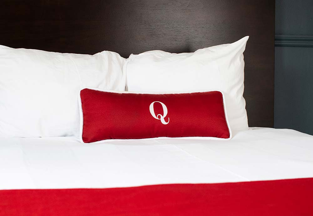decorative pillow on large bed