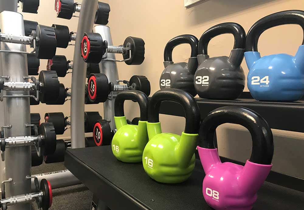 Weight and kettlebells in weight room