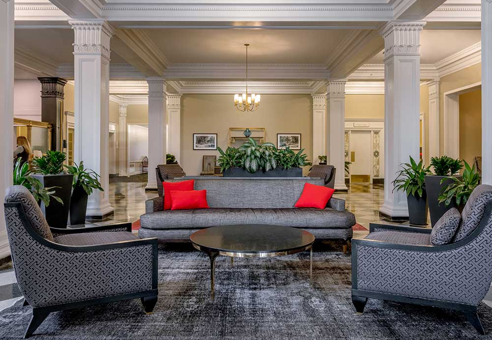 hotel lobby with chairs and sofa