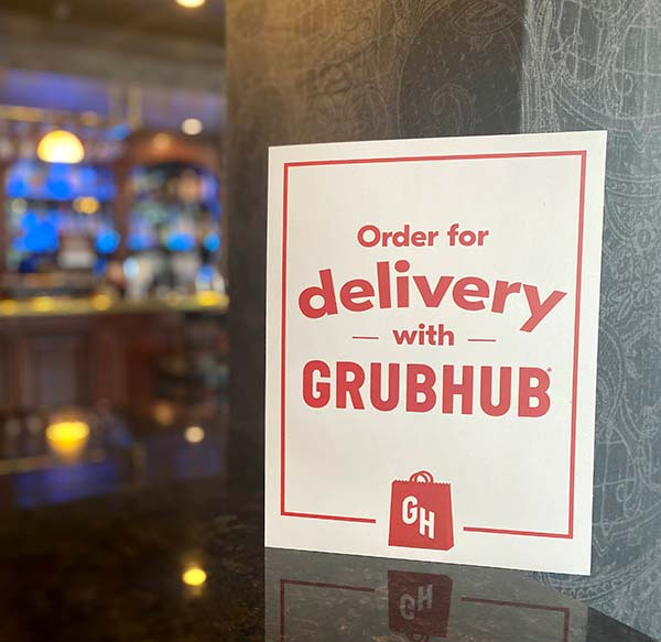 Order of delivery with Grubhub sign