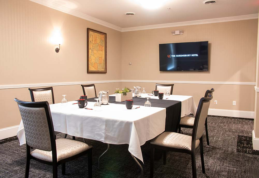 Small conference room with TV mounted on wall