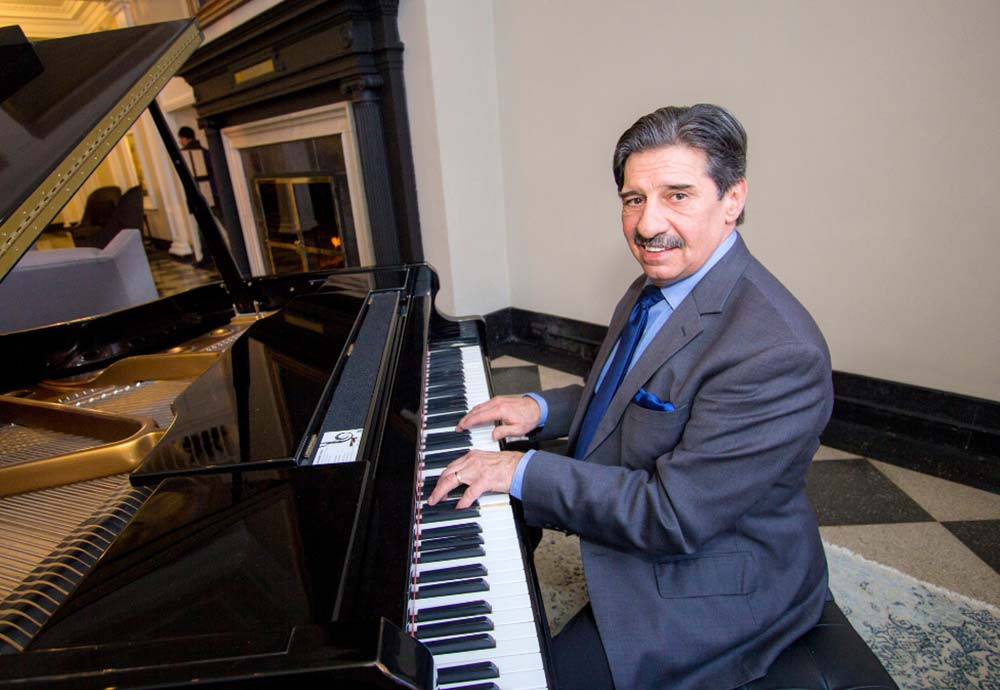 Man in suit playing piano
