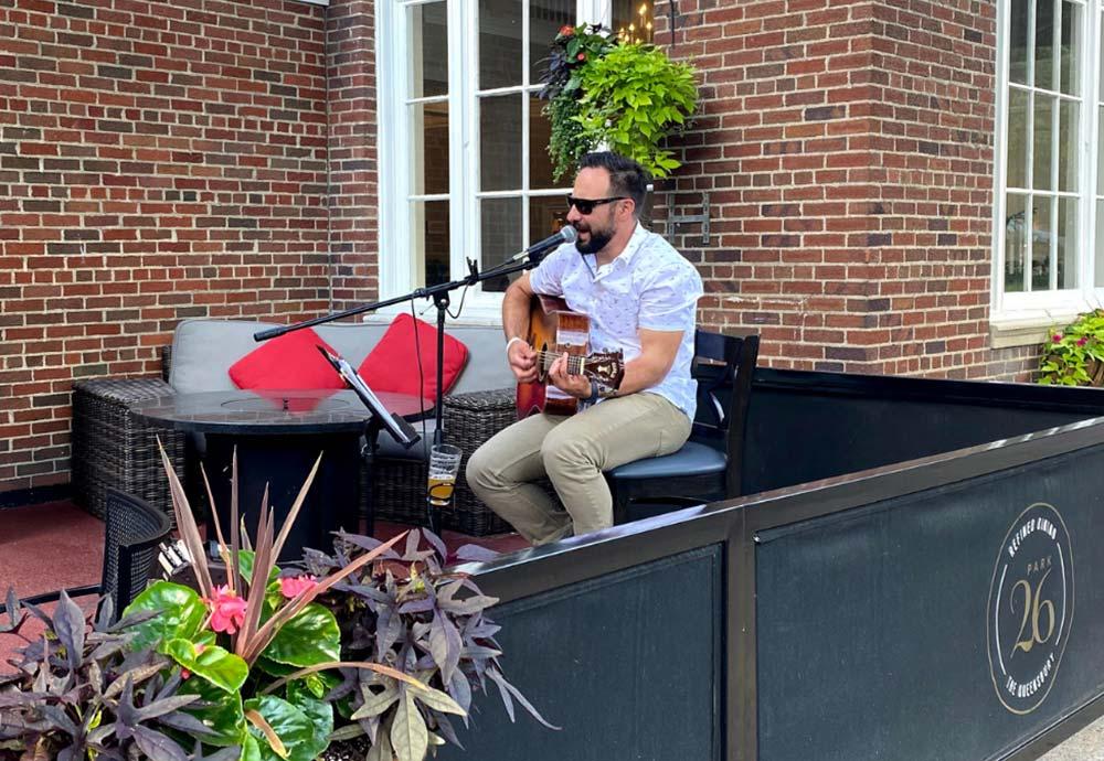 Man playing guitar on patio
